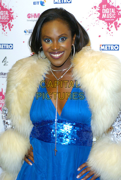 KELLE BRYAN.At the BT Digital Music Awards,.The Roundhouse, Camden,London, england,.October 3rd 2006..half length kelly blue glitter dress cream white fur collar trim coat hand on hip.Ref: CAN.www.capitalpictures.com.sales@capitalpictures.com.©Can Nguyen/Capital Pictures