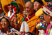 The Dalai Lama is surrounded by a crowd of ethnic Tibetans in traditional costumes at the Alliant Energy Center in Madison, Wisconsin