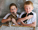 Kids show off their bunnies in the petting zoo at the 2008 Cantaloupe  Festival.  Photo by Tom Smedes.