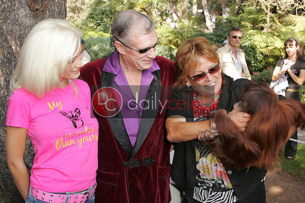 Holly Madison with Hugh Hefner and Martine Colette<br />