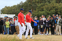 Tiger Woods (USA) and Justin Thomas (USA) waking off the 10th tee during the First Round - Four Ball of the Presidents Cup 2019, Royal Melbourne Golf Club, Melbourne, Victoria, Australia. 12/12/2019.<br /> Picture Thos Caffrey / Golffile.ie<br /> <br /> All photo usage must carry mandatory copyright credit (© Golffile | Thos Caffrey)