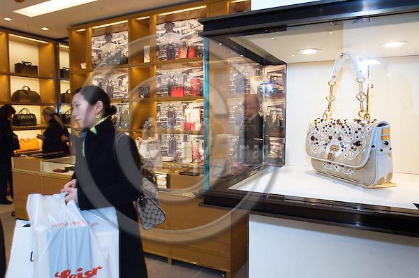 BERLIN - GERMANY 19. 2. 2007 -- A woman passes a Luis Vitton handbag -- PHOTO: GORM K. GAARE / EUP- IMAGES .
