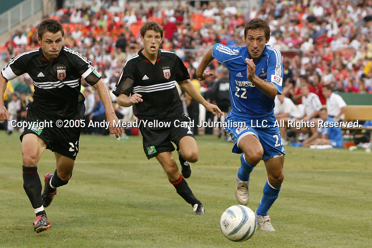 9 July 2005: Davy Arnaud (22) tries to get past Dema Kovalenko (21) and Brandon Prideaux (4). The Kansas City Wizards defeated DC United 1-0 at RFK Stadium in Washington, DC in a regular season Major League Soccer game. .