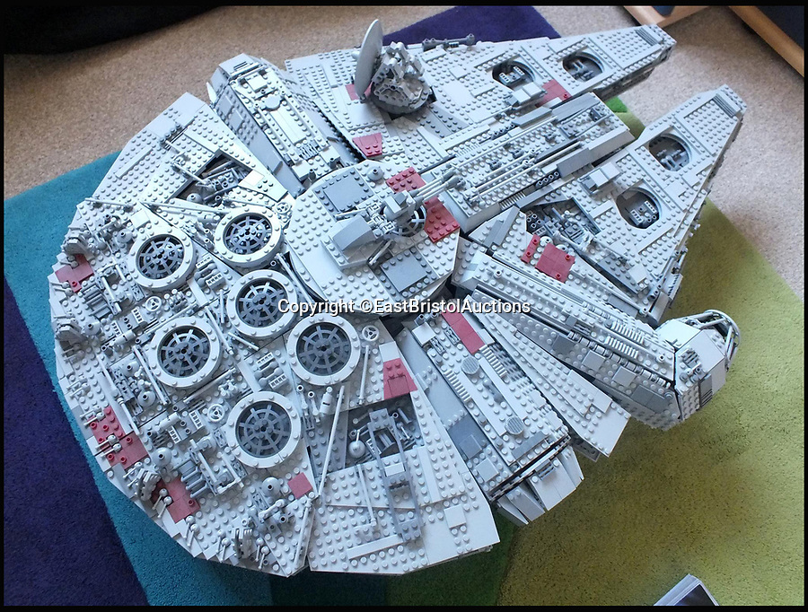 BNPS.co.uk (01202 558833)<br /> Pic: EastBristolAuctions/BNPS<br /> <br /> What the Falcon will look like once completed.<br /> <br /> The 'holy grail' of Star Wars Lego - a massive version of the Millennium Falcon - that has been built and dismantled has emerged for sale for £2,200.<br /> <br /> The ultra-rare model is a 'to scale' replica of Han Solo's famous star ship. <br /> <br /> Crafted from over 5,000 pieces, it is the most spectacular and largest Star Wars Lego set ever produced.<br /> <br /> It is 100 per cent complete and comes in its original box with an enormous 311 page instruction manual.<br /> <br /> It's being sold by its original owner, a man from London who bought the set new from Toys R Us, assembled it and displayed it in his home.