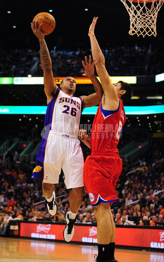 Dec. 28, 2011; Phoenix, AZ, USA; Phoenix Suns guard Shannon Brown (26) takes a shot during game against the Philadelphia 76ers at the US Airways Center. The 76ers defeated the Suns 103-83. Mandatory Credit: Mark J. Rebilas-USA TODAY Sports