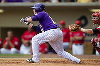 LSU Tigers third baseman Tyler Hanover #11 bunt during the NCAA Super Regional baseball game against Stony Brook on June 9, 2012 at Alex Box Stadium in Baton Rouge, Louisiana. Stony Brook defeated LSU 3-1. (Andrew Woolley/Four Seam Images)