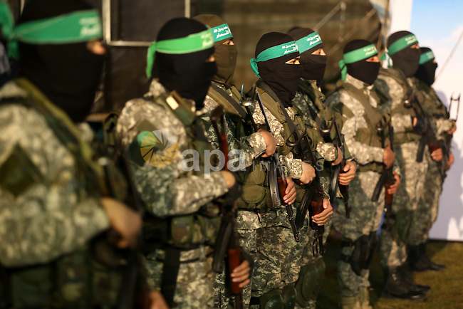 Palestinian members of the Ezzedine al-Qassam Brigades, the armed wing of the Hamas movement, take part in a gathering on January 31, 2016 in Gaza city to pay tribute to their fellow militants who died after a tunnel collapsed in the Gaza Strip. Seven Hamas militants were killed on January 28, 2016 after a tunnel built for fighting Israel collapsed in the Gaza Strip, highlighting concerns that yet another conflict could eventually erupt in the Palestinian enclave. Photo by Mohammed Asad