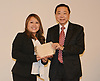 Dr. Leung presents Park Place ES teacher Yen Trieu with the Outstanding Asian-Pacific American award and $500.