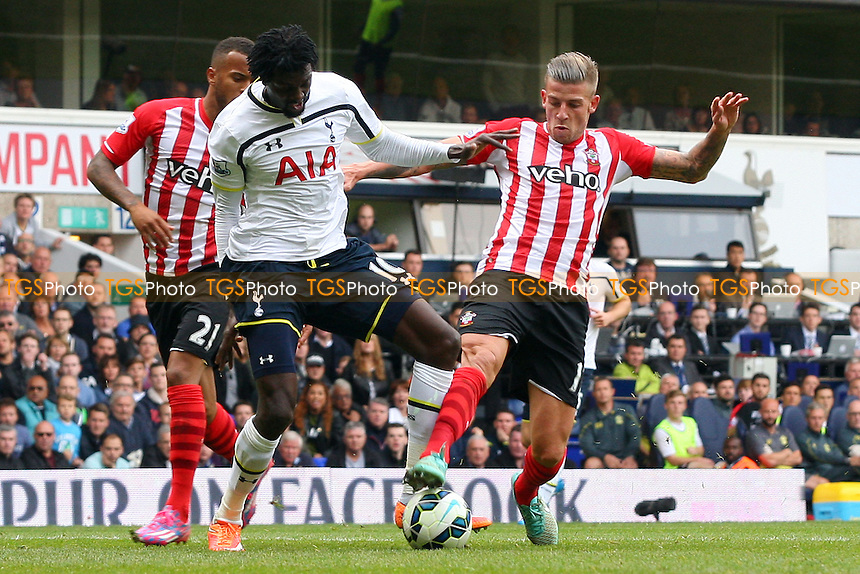 Emmanuel Adebayor of Tottenham Hotspur and Toby Alderweireld of Southampton - Tottenham Hotspur vs Southampton - Barclays Premier League action at the White Hart Lane Stadium on 05/10/2014 - MANDATORY CREDIT: Dave Simpson/TGSPHOTO - Self billing applies where appropriate - 0845 094 6026 - contact@tgsphoto.co.uk - NO UNPAID USE