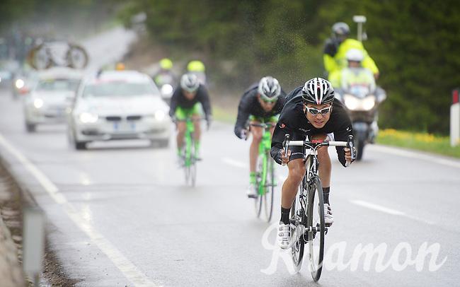 Fumy Beppu (JAP/Trek Factory Racing) descending the Passo San Pellegrino (1918m) in the rain<br /> <br /> 2014 Giro d'Italia<br /> stage 18: Belluno - Rifugio Panarotta (Valsugana), 171km