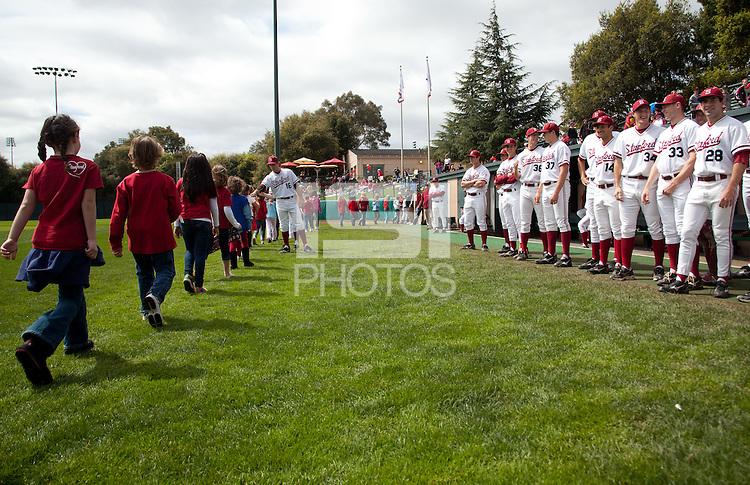 STANFORD, CA - March 27, 2011: Singers from Addison Elementary  walk off the field after singing the National Anthem before Stanford's game against Long Beach State at Sunken Diamond. Stanford won 6-5.
