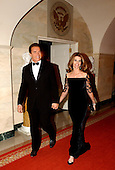 Washington, DC - February 22, 2004 -- California Governor Arnold Schwarzenegger and his wife, Maria Shriver, arrive at the White House in Washington, DC on February 22, 2004.  They were attending the 2004 National Governors Association Dinner with United States President George W. Bush..Credit: Ron Sachs / CNP