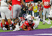 Ohio State Buckeyes running back J.K. Dobbins (2) scores a touchdown against Northwestern Wildcats during the 1st quarter in the Big Ten Championship game in Indianapolis, Ind on December 1, 2018.  [Kyle Robertson/Dispatch]