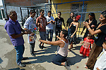 "THIS PHOTO IS AVAILABLE AS A PRINT OR FOR PERSONAL USE. CLICK ON ""ADD TO CART"" TO SEE PRICING OPTIONS.   Participant dance in the street during a wedding in Suto Orizari, Macedonia. The mostly Roma community, located just outside Skopje, is considered Europe's largest Roma settlement. ."