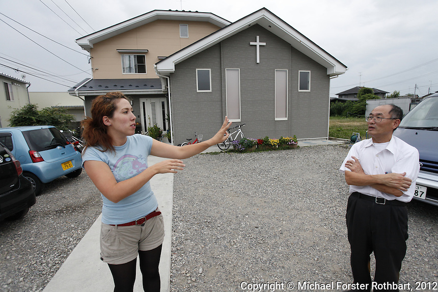 Pastor Nobumasa Tajima argues with his daughter Christine about whether it was unsafe after the Fukushima Daiichi disaster to let her children play in the grass beside the church. Nobumasa Tajima, a Japanese-American, runs the Koriyama Baptist Church with his wife Beverly.<br /> ------------------- <br /> This photograph is part of Michael Forster Rothbart&rsquo;s After Fukushima documentary photography project.<br /> &copy; Michael Forster Rothbart 2007-2013.<br /> www.afterchernobyl.com<br /> www.mfrphoto.com &bull; 607-267-4893 &bull; 607-436-2856<br /> 34 Spruce St, Oneonta, NY 13820<br /> 86 Three Mile Pond Rd, Vassalboro, ME 04989<br /> info@mfrphoto.com<br /> Photo by: Michael Forster Rothbart<br /> Date:  7/23/2012<br /> File#:  Canon &mdash; Canon EOS 5D Mark II digital camera frame 81551