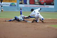 Asheville Tourists shortstop Rosell Herrera #7 tags out Mark Threlkeld #26 as he slides past the bag during a game against the Lexington Legends at McCormick Field on June 16, 2013 in Asheville, North Carolina. The Tourists won the game 8-7. (Tony Farlow/Four Seam Images)