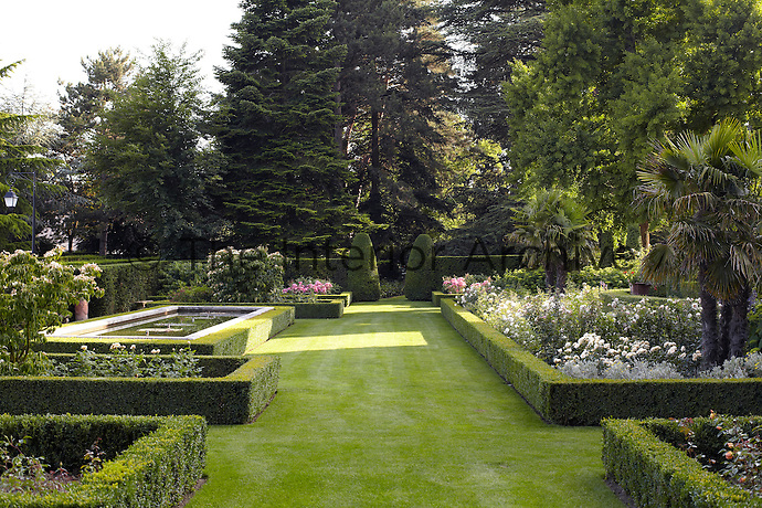 Flowerbeds framed with clipped box hedges are a feature of the manicured garden