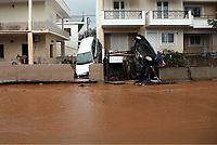 Pictured: Cars are wedged against houses.<br /> Re: People have died, some still missing and severe damage caused by heavy rain and flash flooding in the area of Mandra, near Athens, Greece. Thursday 16 November 2017