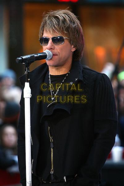 "JON BON JOVI.Bon Jovi perfroms live on NBC's ""TODAY"" Show, New York, NY, USA..November 12th, 2010.stage concert live gig performance music half length black coat sunglasses shades singing.CAP/ADM/PZ.©Paul Zimmerman/AdMedia/Capital Pictures."