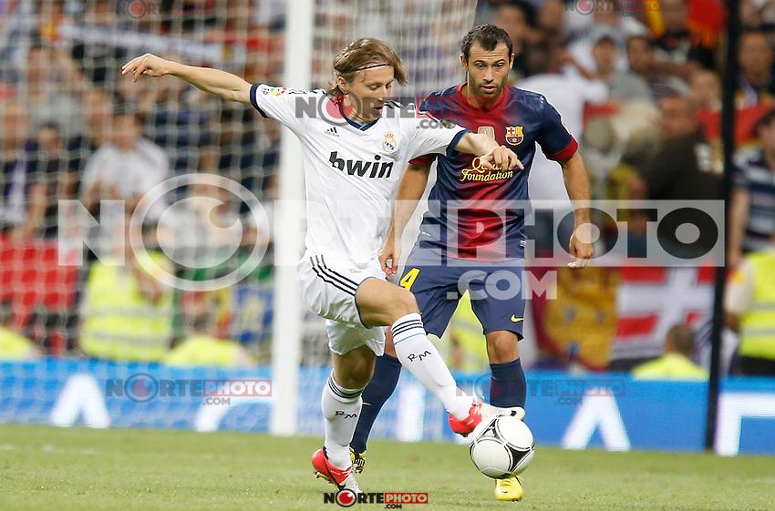 Real Madrid's Luka Modric against Barcelona's Javier Mascherano during Super Cup match. August 29, 2012. (ALTERPHOTOS/Alvaro Hernandez). /NortePhoto.com<br /> <br /> **CREDITO*OBLIGATORIO** <br /> *No*Venta*A*Terceros*<br /> *No*Sale*So*third*<br /> *** No*Se*Permite*Hacer*Archivo**<br /> *No*Sale*So*third*