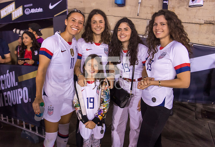 PASADENA, CA - AUGUST 4: Ali Krieger #11 poses with the family of Gianni Infantino during a game between Ireland and USWNT at Rose Bowl on August 3, 2019 in Pasadena, California.