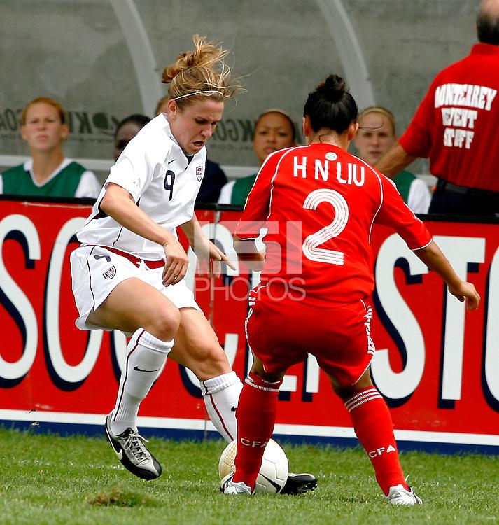 U.S. National Team forward Heather O'Reilly (9) takes on China defender Liu Huana.  The U.S. Women's National Team defeated China 4-1 at Toyota Park in Bridgeview, IL on August 28, 2006.