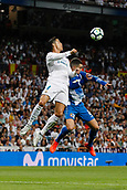 1st October 2017, Santiago Bernabeu, Madrid, Spain; La Liga football, Real Madrid versus Espanyol; Cristiano Ronaldo dos Santos (7) Real Madrid wins the header from Mario Hermoso (22) Espanyol
