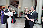 In this photo provided by the Ronald Reagan Presidential Library, Tom Selleck dances with Nancy Reagan, left, and Princess Diana and Clint Eastwood dance, right, in the Cross Hall of the White House in Washington, D.C. at a Dinner for Prince Charles and Princess Diana of the United Kingdom on November 9, 1985.<br />