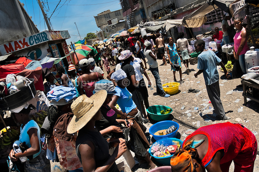 Haitian women sell food supplies and smuggled goods on the street market in Port-au-Prince, Haiti, 13 July 2008.