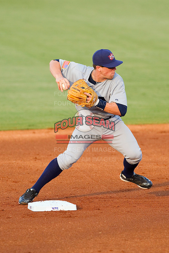 Second baseman Nolan Fontana #4 (Florida) of the USA Baseball Collegiate National Team turns a double play against the USA 18u National Team at the USA Baseball National Training Center on July 2, 2011 in Cary, North Carolina.  The College National Team defeated the 18u team 8-1.  Brian Westerholt / Four Seam Images