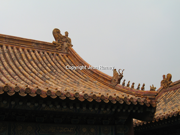 Phoenix statues on roof to protect the palace from lightning and fire. Forbidden Palace, Beijing, China