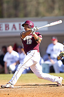 Jose Rodriguez #19 of the College of Charleston Cougars follows through on his swing against the Davidson Wildcats at Wilson Field on March 12, 2011 in Davidson, North Carolina.  The Wildcats defeated the Cougars 8-3.  Photo by Brian Westerholt / Four Seam Images