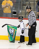 Bob Bernard escorts Grant Potulny's son off the ice. - The University of Minnesota-Duluth Bulldogs defeated the University of Michigan Wolverines 3-2 (OT) to win the 2011 D1 National Championship on Saturday, April 9, 2011, at the Xcel Energy Center in St. Paul, Minnesota.