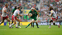 Blair Cowan of London Irish attacks in midfield as he is challenged by Nick Evans (left) and Marland Yarde of Harlequins during the Premiership Rugby Round 1 match between London Irish and Harlequins at Twickenham Stadium on Saturday 6th September 2014 (Photo by Rob Munro)
