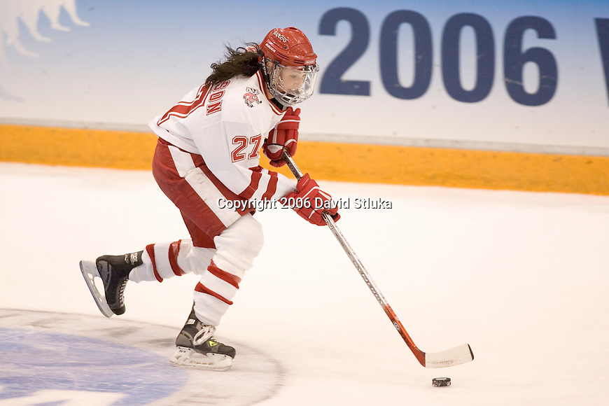 MINNEAPOLIS, MN - MARCH 26: Meaghan Mikkelson #27 of the Wisconsin Badgers women's hockey handles the puck against the Minnesota Golden Gophers at Mariucci Arena during the Women's Frozen Four Tournament final on March 26, 2006 in Minneapolis, Minnesota. The Badgers beat the Gophers 3-0. (Photo by David Stluka)
