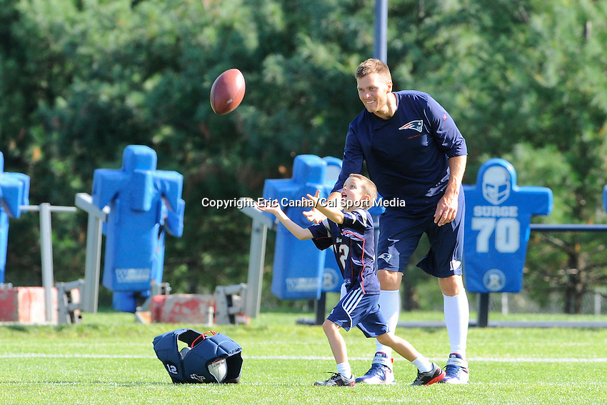 August 15, 2013 - Foxborough, Massachusetts, U.S. - New England Patriots quarterback Tom Brady (12) plays catch with his son Jack at the end of the New England Patriots training camp at Gillette Stadium in Foxborough Massachusetts.   Eric Canha/CSM