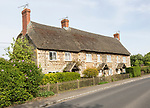 Terrace of historic thatched cottages at village of Sandy Lane, Wiltshire, England, UK