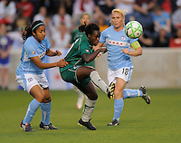 # 9 Eniola Aluka  of St. Louis Athletica  passe the ball against the defense of the Chicago Reds. Athletica beat the Red Stars 2-0...