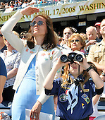 Washington, DC - April 17, 2008 -- Martha O'Hanlon of Silver Spring, Maryland, left, shields her eyes from the sun as her son, Patrick O'Hanlon uses binoculars to see Pope Benedict XVI celebrate Mass at the new Nationals Park in Washington, D.C. on Thursday, April 17, 2008. This is the first non-baseball event in the park, which opened March 31.  .Credit: Ron Sachs / CNP.(RESTRICTION: NO New York or New Jersey Newspapers or newspapers within a 75 mile radius of New York City)