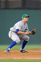 Third baseman Hunter Dozier (13) of the Lexington Legends plays in a game against the Greenville Drive on Friday, August, 16, 2013, at Fluor Field at the West End in Greenville, South Carolina. Dozier was the No. 1 pick (eighth overall) by the Kansas City Royals in the first round of the 2013 First-Year Player Draft. He played collegiate ball for Stephen F. Austin University. Greenville won, 2-1. (Tom Priddy/Four Seam Images)