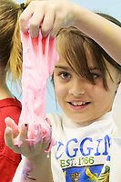 NWA Democrat-Gazette/CHARLIE KAIJO Karina Coello, 8, of Bentonville plays with slime she made during a summer art workshop, Thursday, July 5, 2018 at Imagine Studios in Rogers. <br /><br />Imagine Studios will host nine weeks of summer art camps and workshops, each with different themes. Activities include canvas painting, pottery painting, slime making and water color painting.
