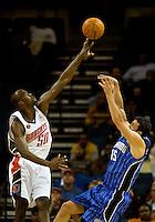 Charlotte Bobcats center Emeka Okafor (50) shoots the ball over Orlando Magic forward Hedo Turkoglu (15) during an NBA basketball game at Time Warner Cable Arena in Charlotte, NC.