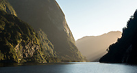 Sun rises in Doubtful Sound, Fiordland National Park, UNESCO World Heritage Area, Southland, New Zealand, NZ