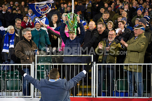 Former Bath Rugby player Mark Regan hands the Heineken Cup trophy to a member of the crowd at half-time. European Rugby Champions Cup match, between Bath Rugby and the Scarlets on January 12, 2018 at the Recreation Ground in Bath, England. Photo by: Patrick Khachfe / Onside Images