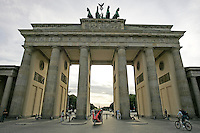 Pedestrians and cyclists passing through Brandenburger Tor, Berlin, Germany