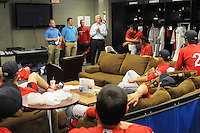 Co-owner Craig Brown, white shirt, center, of the Greenville Drive talks to his team in the clubhouse on the team's Media Day first workout on Tuesday, April 1, 2014, at Fluor Field at the West End in Greenville, South Carolina. (Tom Priddy/Four Seam Images)