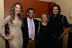 CORAL GABLES, FL - JULY 17: (EXCLUSIVE) Claudia Elena Vives, Humberto M. Speziani, wife and Carlos Vives poses backstage during the Premios Juventud 2014 at The BankUnited Center on July 17, 2014 in Coral Gables, Florida.  (Photo by Johnny Louis/jlnphotography.com)
