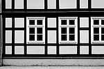 The photograph of the facade of a half-timbered house.