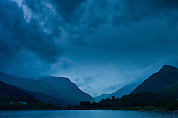 Llanberis Pass with Snowdonia on right, Dolbadarn Castle and Llyn Padarn lake, in Snowdonia National Park, Wales