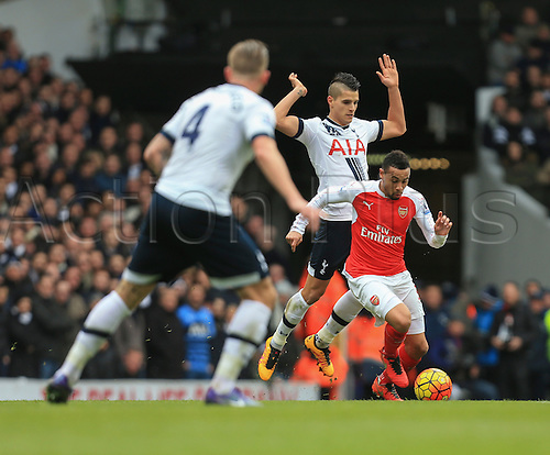 05.03.2016. White Hart Lane, London, England. Barclays Premier League. Tottenham Hotspur versus Arsenal. Francis Coquelin of Arsenal gets away from Erik Lamela of Tottenham Hotspur.